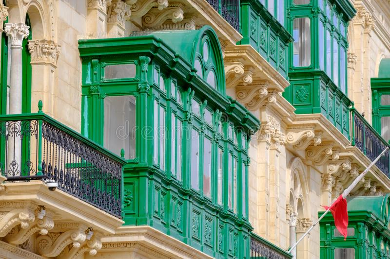 View on the streets with green balconies in street of Valletta, Malta stock photos