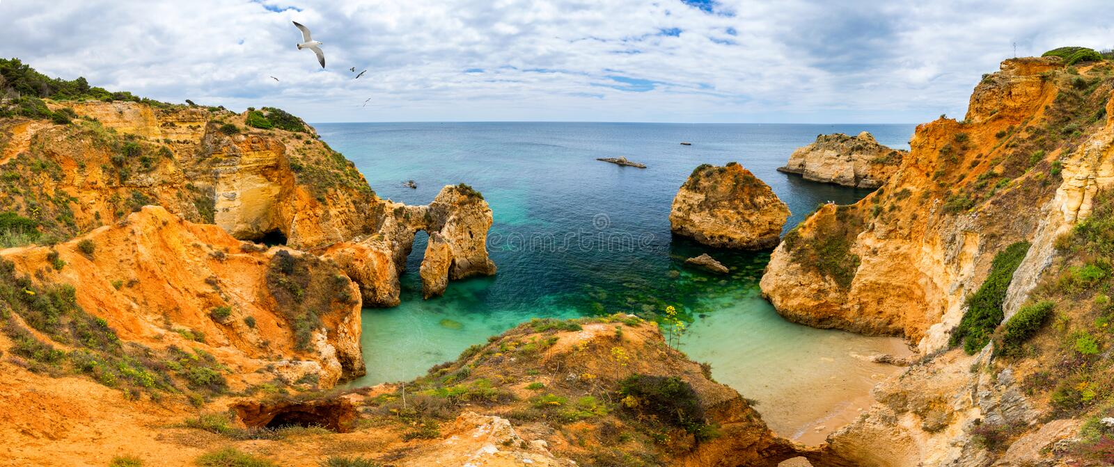 View of stunning beach with golden color rocks in Alvor town , Algarve, Portugal. View of cliff rocks on Alvor beach, Algarve royalty free stock images