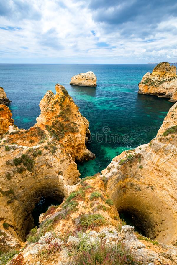 View of stunning beach with golden color rocks in Alvor town , Algarve, Portugal. View of cliff rocks on Alvor beach, Algarve royalty free stock photos