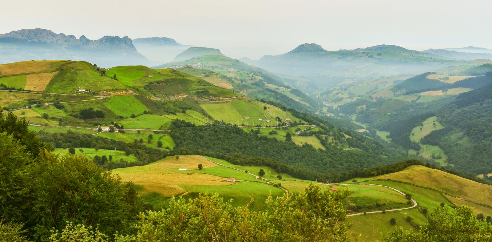 View of summer Spain countryside in misty weather. Panoramic landscape of misty mountains in the morning stock photos
