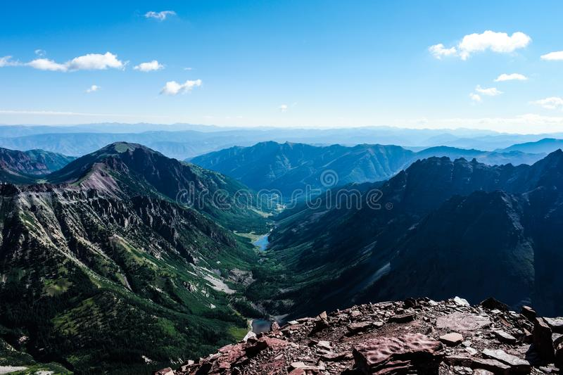 View from the summit of the Maroon Bells, near Aspen Colorado. The Maroon Bells are iconic mountains in the Elk Range, Colorado Rocky Mountains stock photos