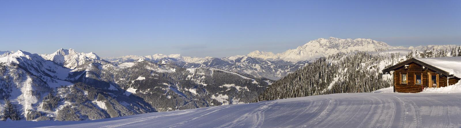 View to The Alps from summit of Shuttleberg, Austria. Panoramic view from summit of Shuttleberg, Ski amade ski resort, Austria royalty free stock photos