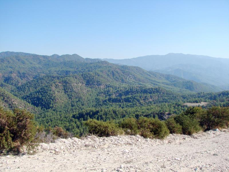 Troodos Mountains Cyprus. Landscapes of mountain horizons at an altitude of 500 m above sea level. A view from the sun-lighted mountain road to the sky blue royalty free stock photography