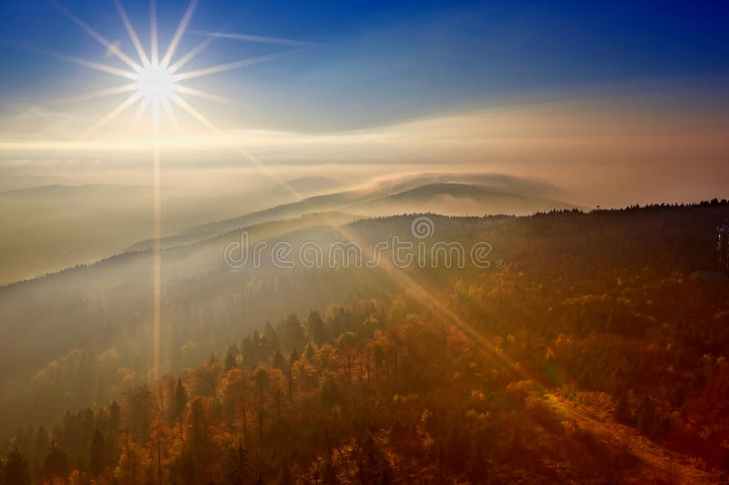 View on the sun over inversion from Jested. Jested-Kozakov ridge, Czech Republic royalty free stock photos