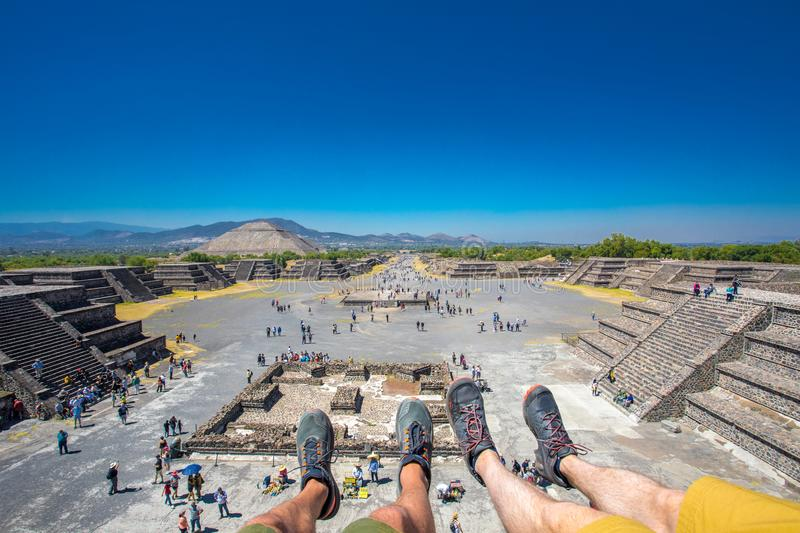 View of the Sun Pyramid and the Alley of Death - City of Teotihuacan Mexico - Ancient Maya Pyramids with abstract footsteps over. stock images