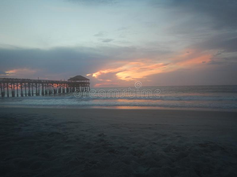 The Cocoa Beach Pier on a cloudy day stock images