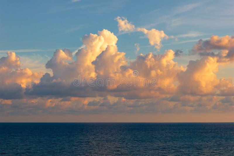 View of the sun setting over the horizon of the sea, ocean. Beautiful sunset sea. Sea sunset background. View of the sun setting over the horizon of the sea royalty free stock photo