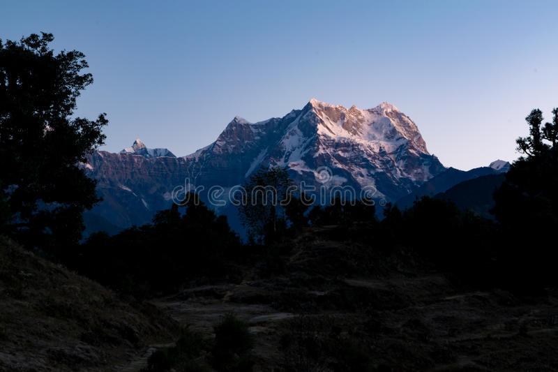View of sunrise on Chaukhamba peaks of Garhwal himalayas of uttrakhand from Deoria Tal camping site. royalty free stock photography