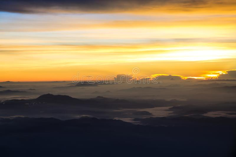 View of a sunrise full of color. From the window of an airplane royalty free stock photo