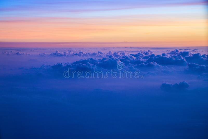 View of a sunrise full of color. From the window of an airplane stock photography