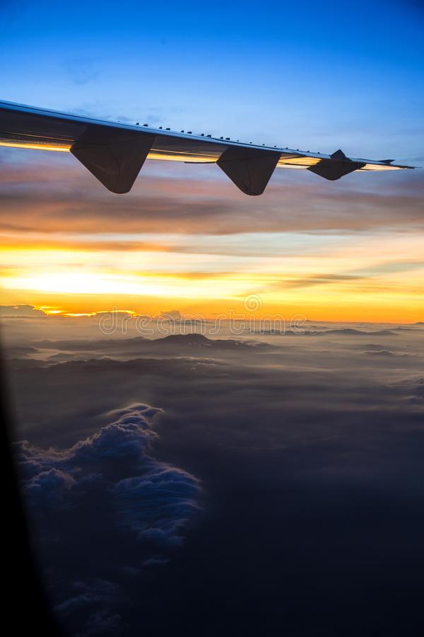 View of a sunrise full of color. From the window of an airplane royalty free stock photography