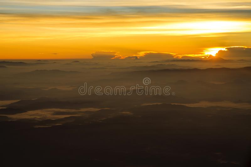 View of a sunrise full of color. From the window of an airplane royalty free stock photos