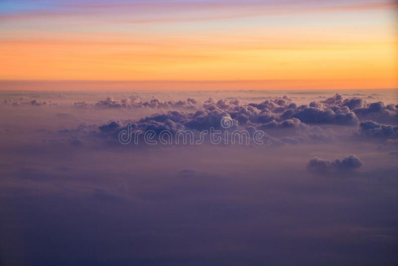 View of a sunrise full of color. From the window of an airplane stock photos