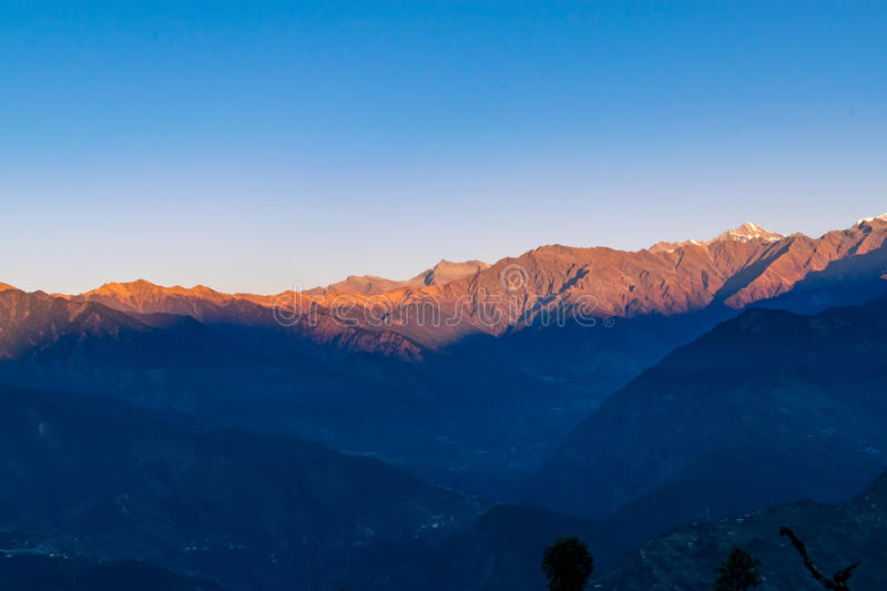 View of sunrise on Garhwal himalayas of uttrakhand from Deoria Tal camping site. stock image