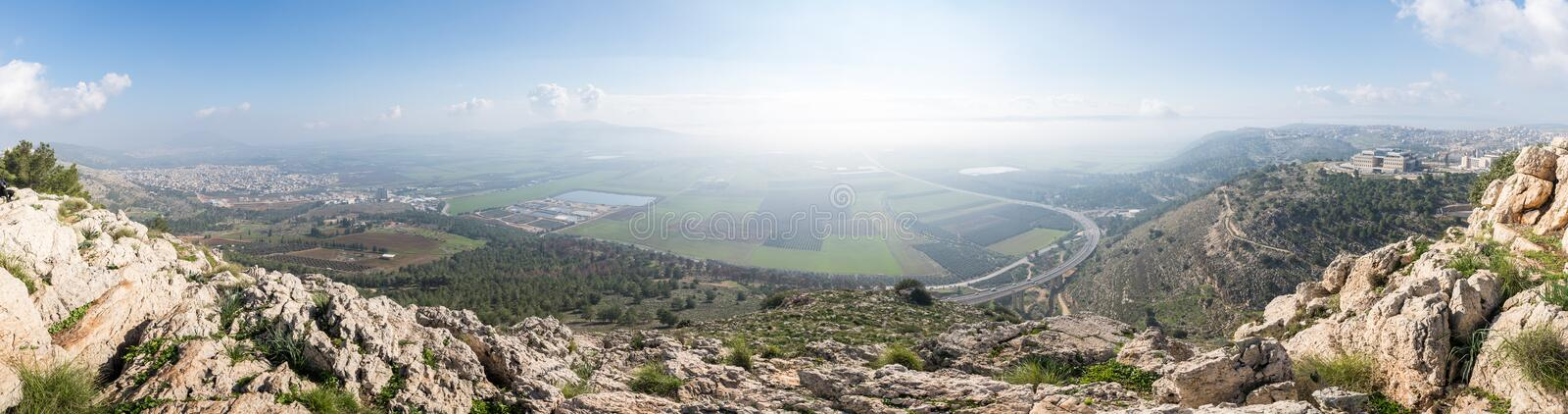 View of the sunrise from the Mount Precipice near Nazareth on the adjacent valley stock photography