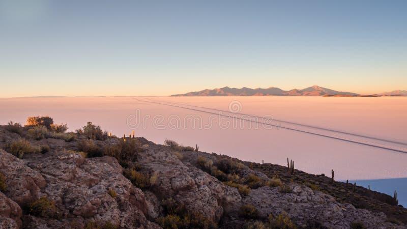 View on sunrise over island incahuasi by salt lake Uyuni in Bolivia. Panoramic royalty free stock photography