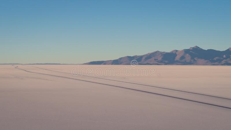 View on sunrise over island incahuasi by salt lake Uyuni in Bolivia. Panoramic stock image