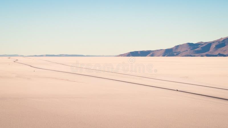View on sunrise over island incahuasi by salt lake Uyuni in Bolivia. Road in the salar royalty free stock photo