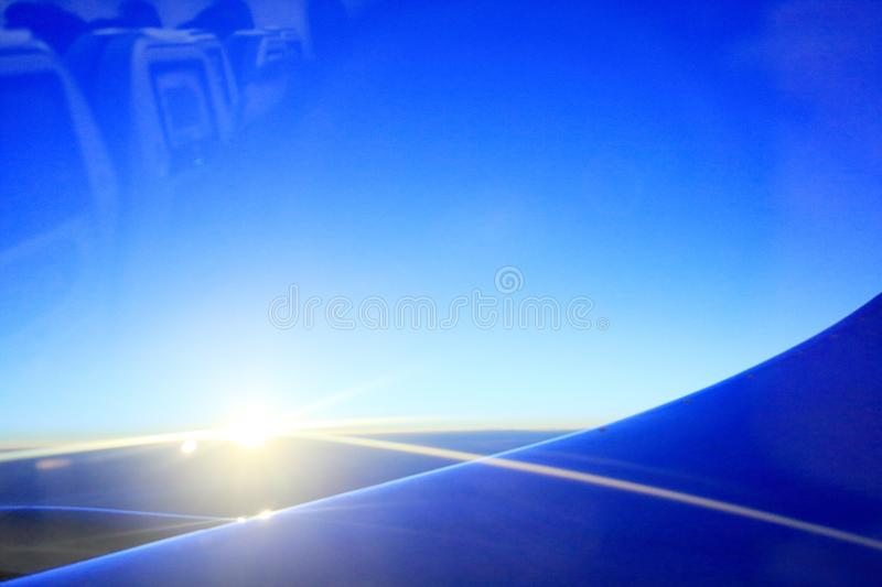 View the sunset through airplane porthole, adobe rgb. Looking at sunset through airplane porthole. porthole reflect aircraft seat stock image