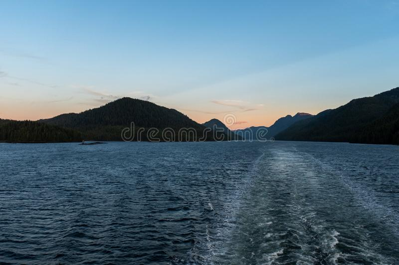 The view at sunset from the back of a ferry as it makes its way through the Inside Passage off the rugged west coast of Canada, royalty free stock photography