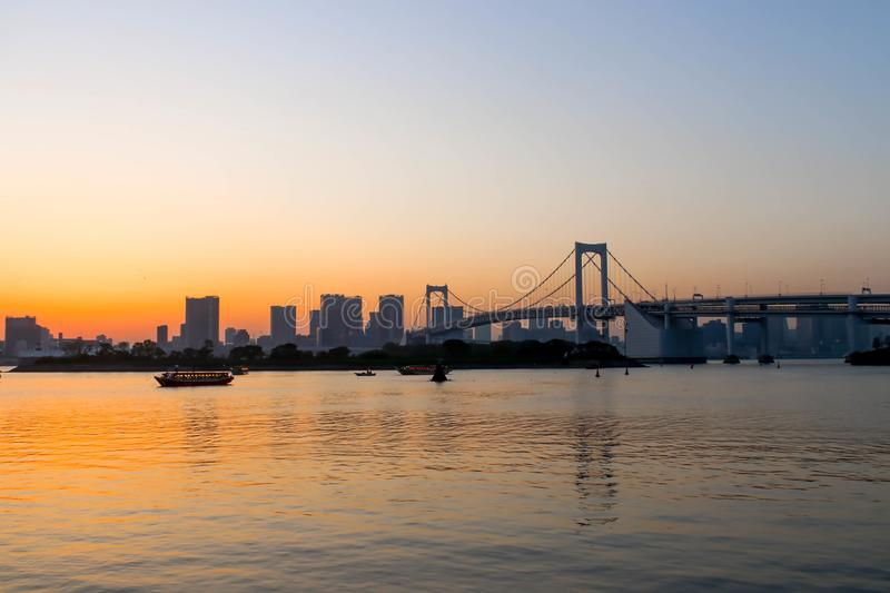View of sunset and boats and rainbow bridge at sumida river suns stock image