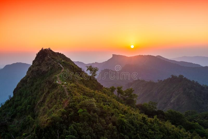 View of sunset over the Phu Chi Fah see from Phu Chi Dao viewpoint in Chiang Rai, Thailand. stock photos