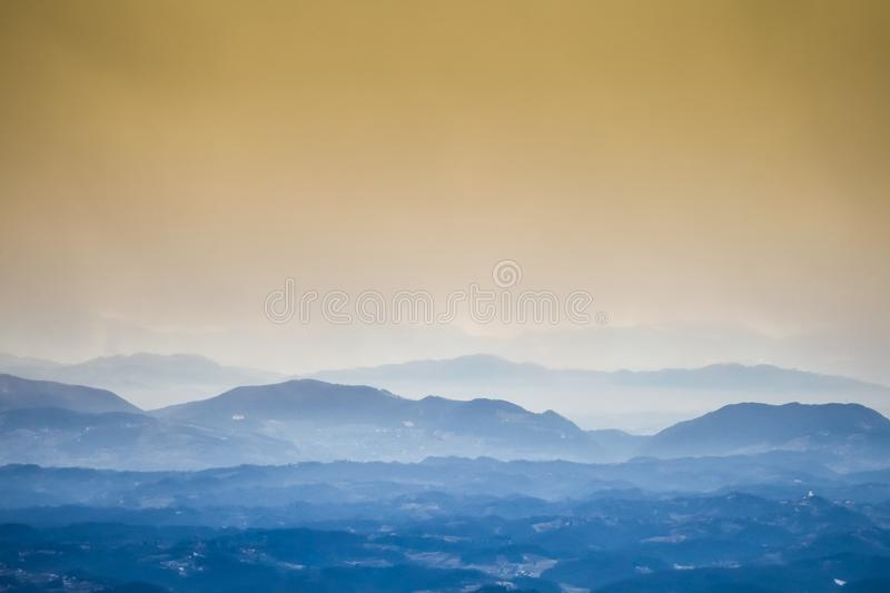 Sunset over hills in countryside stock image