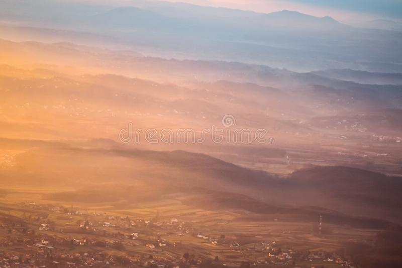 Sunset over hills in countryside stock photos