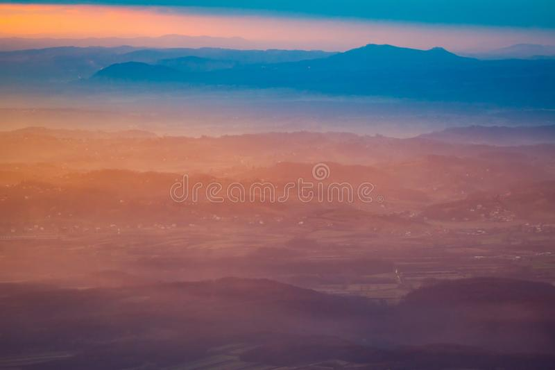 Sunset over hills in countryside stock photography