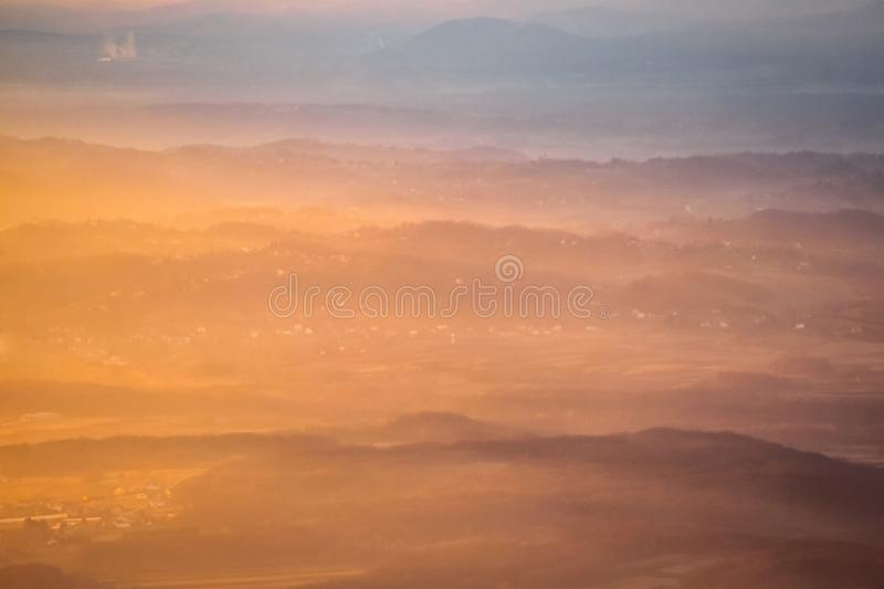 Sunset over hills in countryside stock images