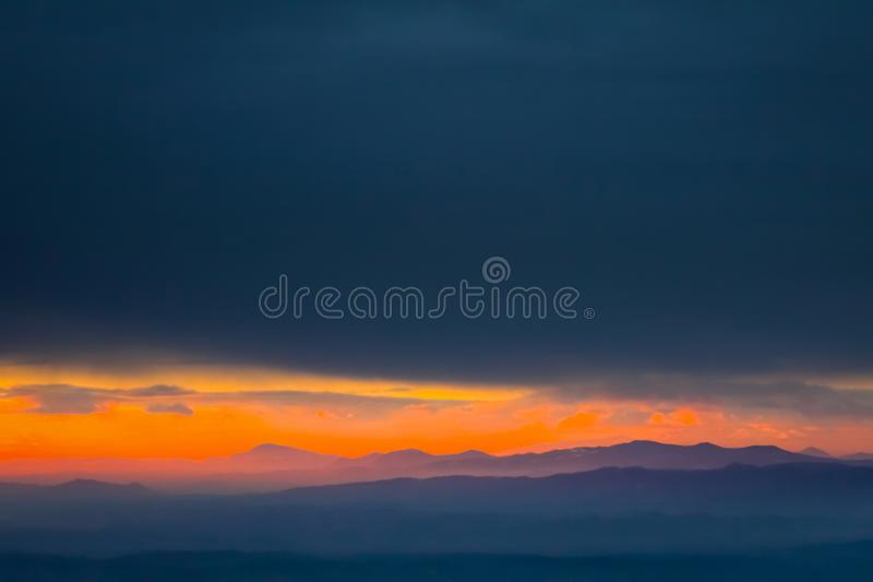 Sunset over hills in countryside royalty free stock photos