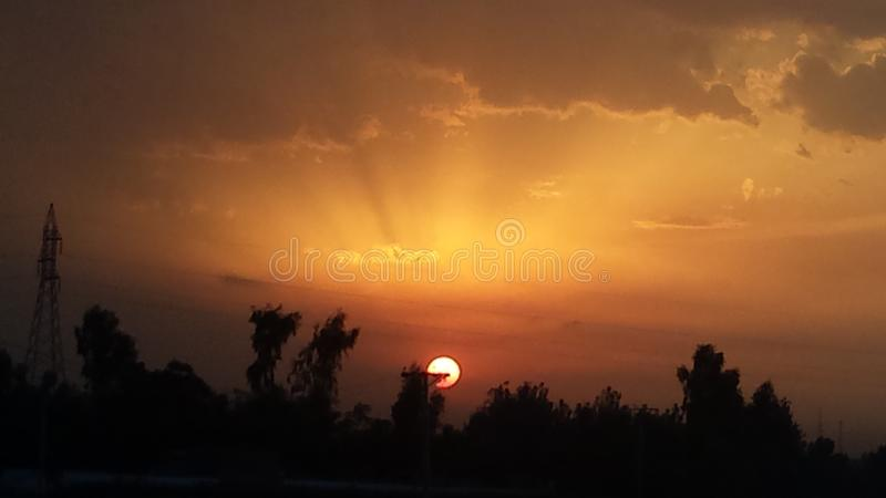Sunset. View of a sunset with rich colors in the atmosphere govt shades of orange and black royalty free stock image
