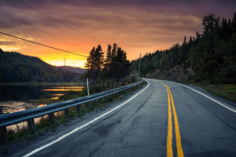 Sunset on the road somewhere in Gaspesie, Quebec, Canada. View of Sunset on the road somewhere in Gaspesie, Quebec, Canada stock images