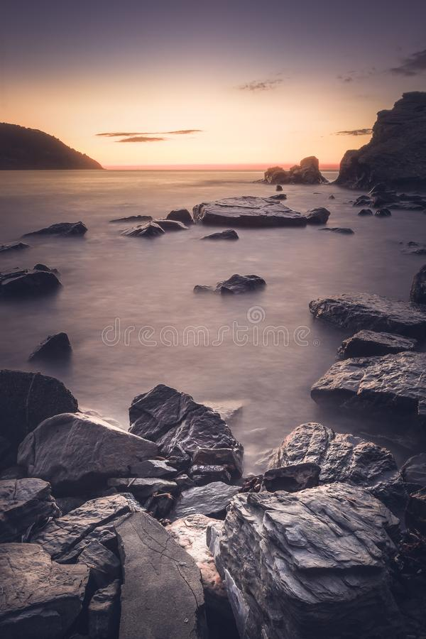 Download View Of A Sunset And In The Foreground Of The Rocks Stock Photo - Image of beach, island: 110877574
