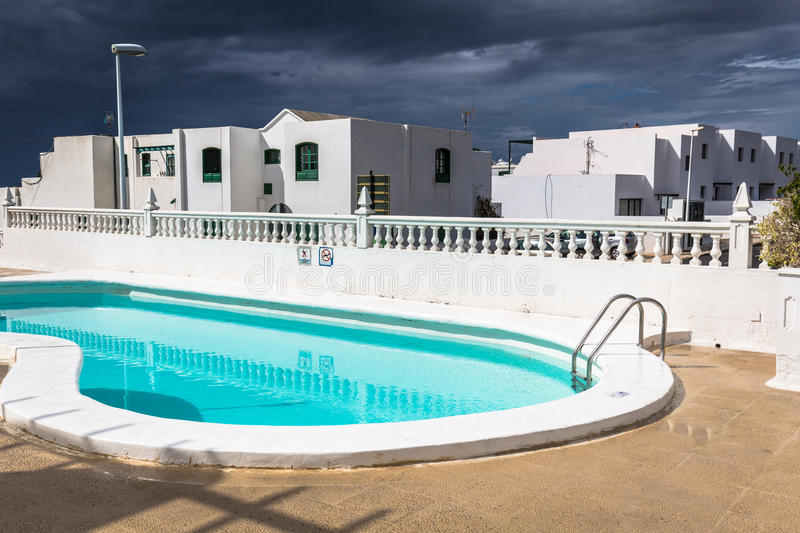 View of the swimming pool in the urbanization Playa Blanca,Lanzarote stock photos