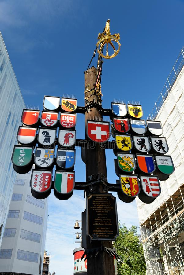 Leicester Square, London, England. View of Swiss Cantonal Tree erected 1991 on Leicester Square in London, England. This Cantonal Tree displays coats of arms of royalty free stock image