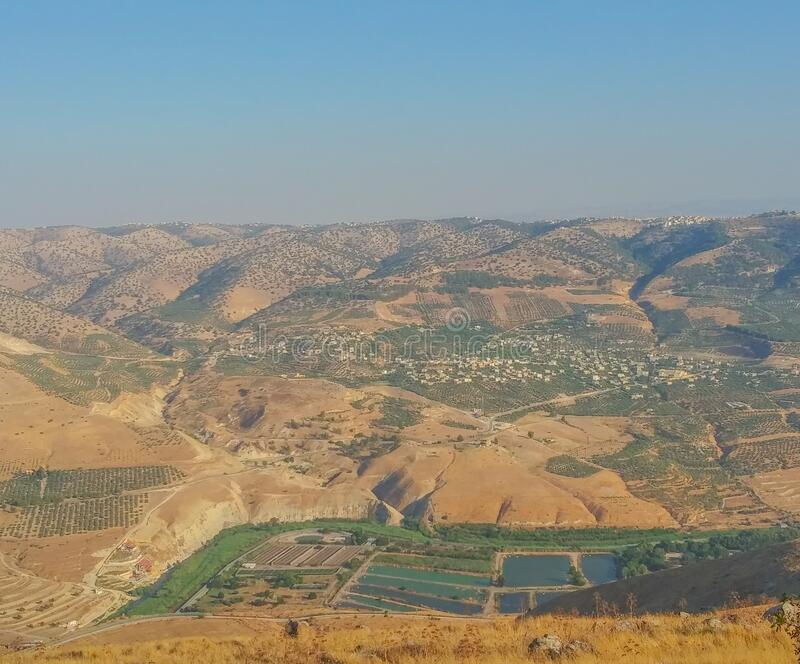 The view of Syrian Arab Republic, from the Golan Heights at the border of Israel.  stock photo