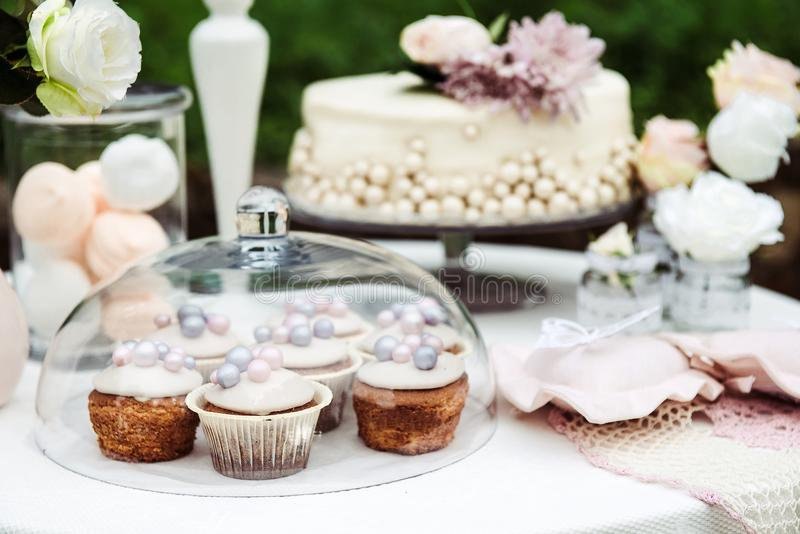 View of the table with a cake, cupcakes stock image