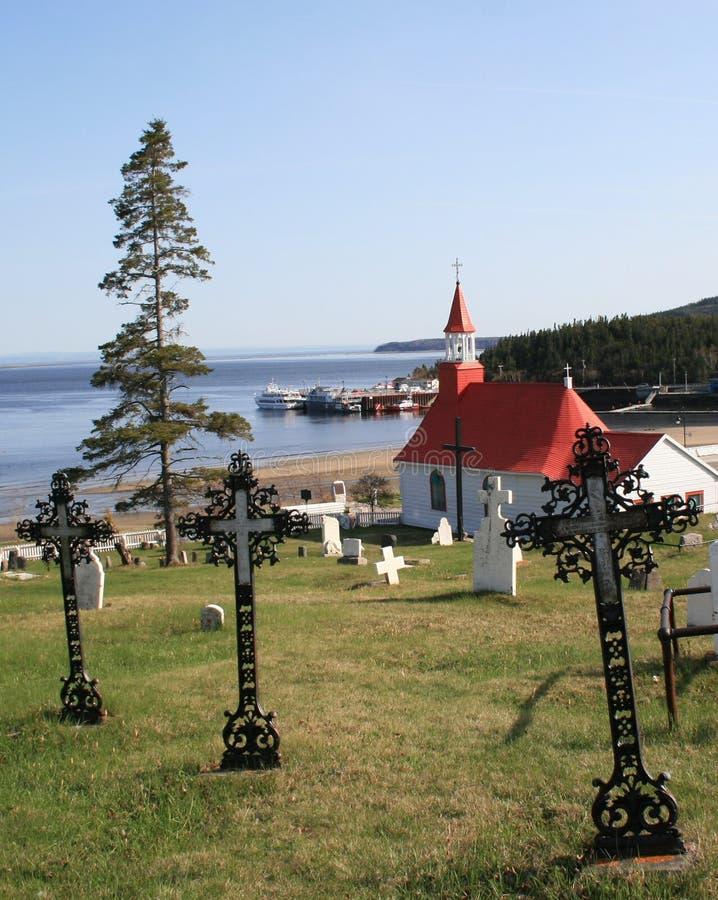 View of Tadoussac, Quebec, Canada. View of the church and lake in Tadoussac, Quebec, Canada in the summer stock photos