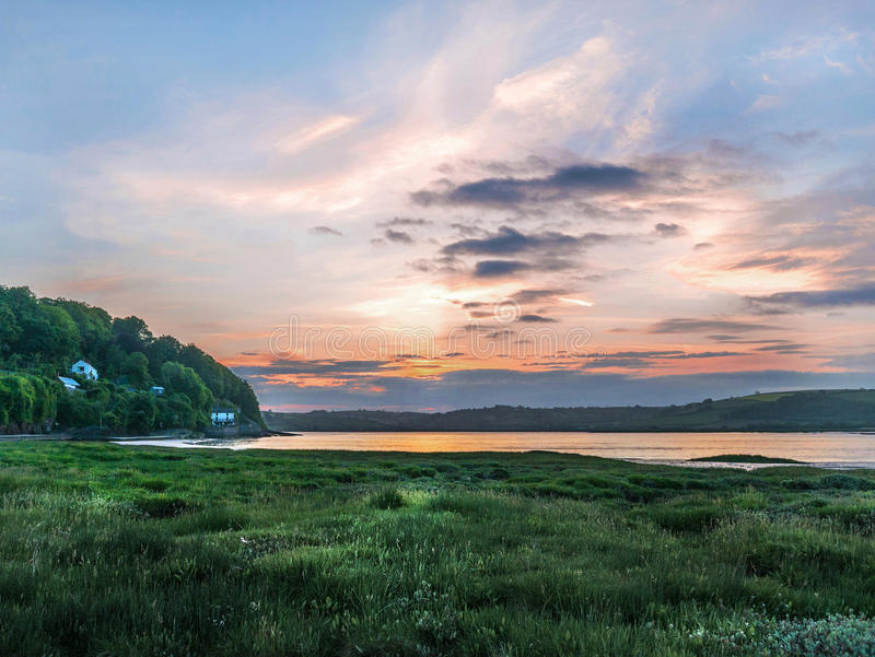 View of the Taf tidal estuary at a beautiful sunrise. Laugharne Taf Estuary and The Boat House at Sunrise Wales stock images