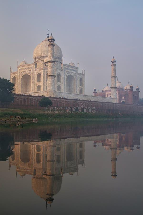 View of Taj Mahal with early morning fog reflected in Yamuna River, Agra, Uttar Pradesh, India royalty free stock photos