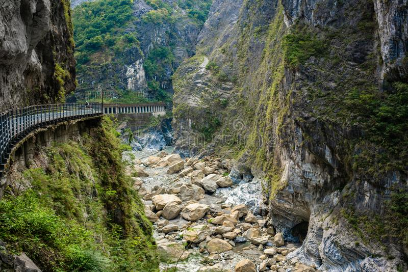 View of Taroko gorge and cliff side pathway of Yanzihkou hiking royalty free stock image