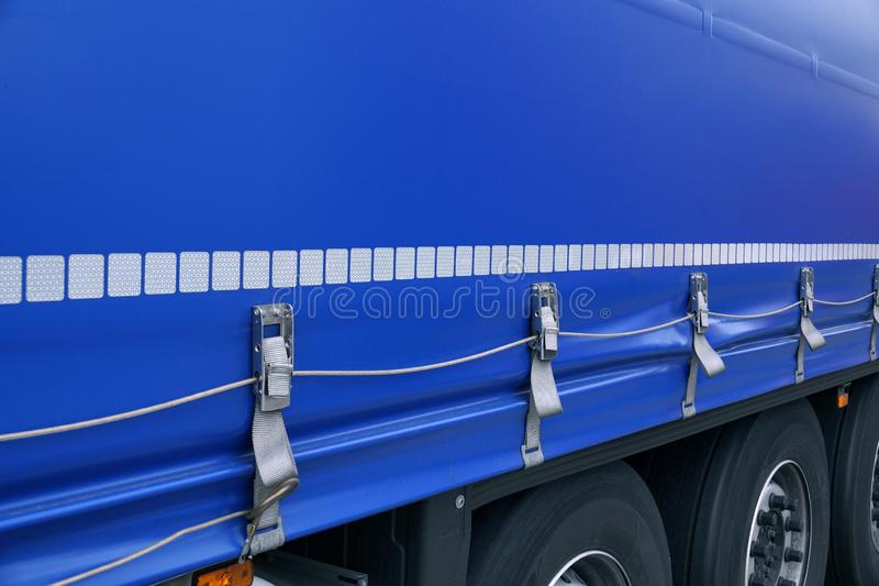 View of the tarpaulin covering the semi-trailer of the truck. Truck transport royalty free stock photography