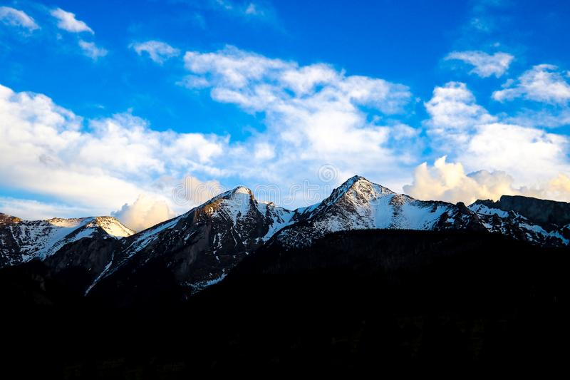 View of Tatra mounains.Tatra mountains in the morning. Beautiful green valley at snowy mountains foothills.  stock photography
