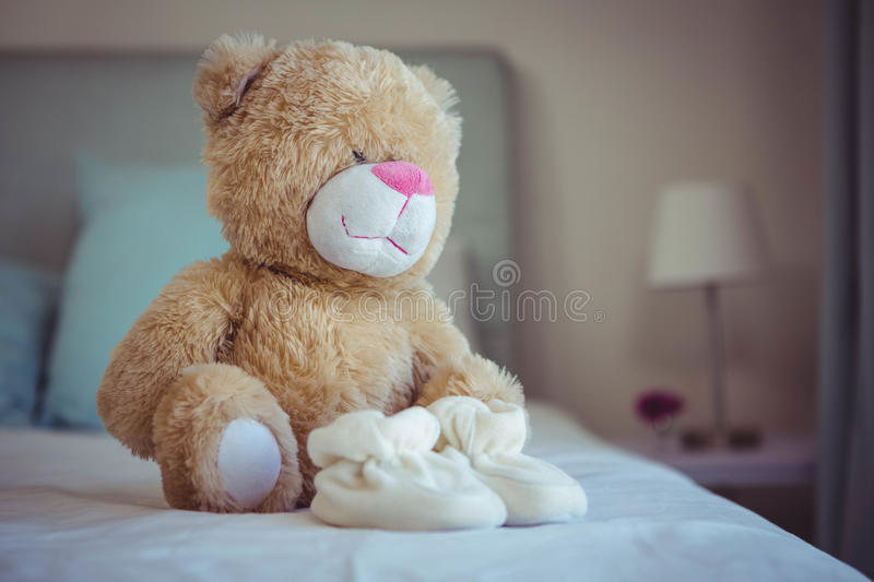 View of teddy bear and baby socks royalty free stock images