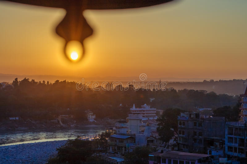 View from the temple under huge bell on River Ganga and Lakshman Jhula bridge at sunset. Rishikesh. royalty free stock images