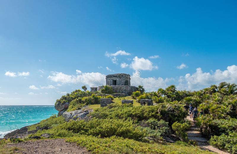 Ancient Mayan ruins of Tulum overlooking the beautiful Caribbean Sea in Mexico royalty free stock image