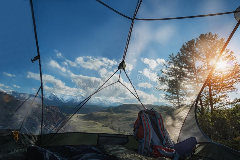 The view from the tent with a mosquito net. Sleep in the open sky stock photography
