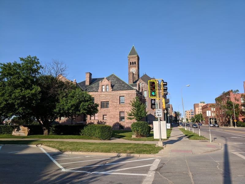 6th Street, Downtown Sioux Falls. View from 6th St. & North Dakota Avenue in Downtown Sioux Falls we see the Minnehaha County Extension Building, the old Sioux royalty free stock photo