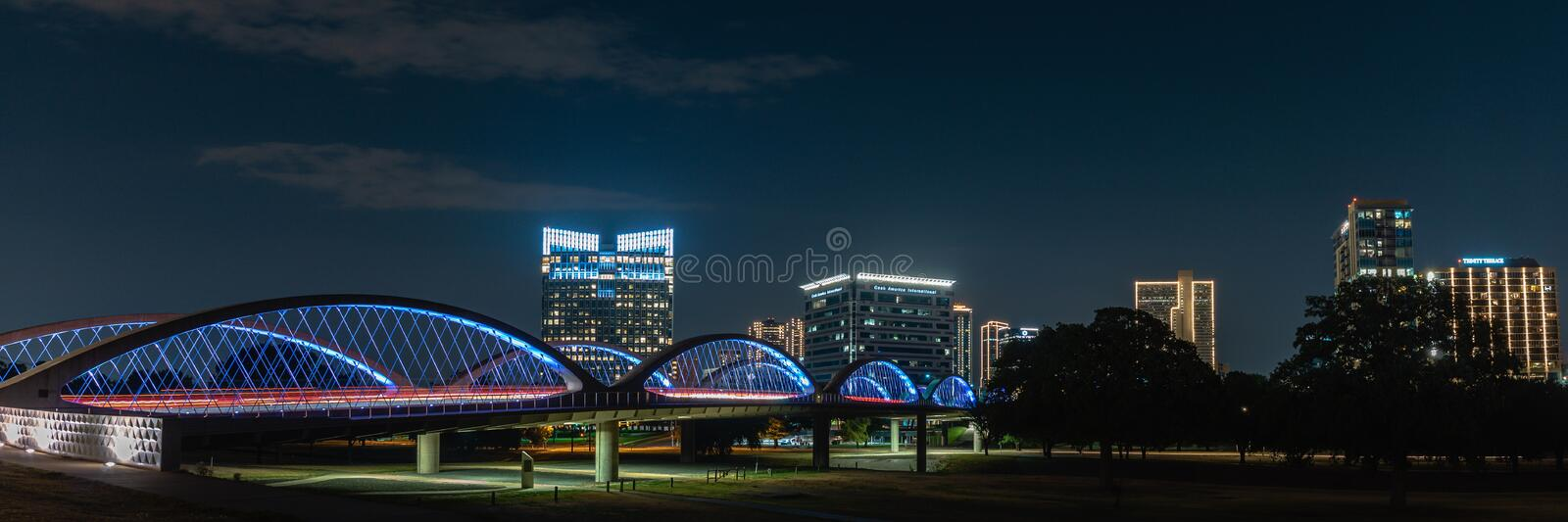 Panorama of 7th Street Bridge and Fort Worth Texas Skyline at Night. A view of the 7th Street Bridge in Fort Worth Texas with the city in the backdrop. This is a stock photos